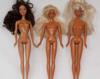 Three Barbie Dolls Two with Blonde Hair blue eyes, One Brown Hair Brown eyes, open Mouths