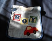 Boy with car, over the head bib