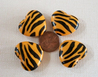 Four Lucite Orange Zebra Heart Beads