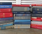 red blue gray book stack one yard high wedding decor photo prop
