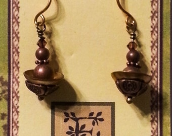 Domed and stacked brass and copper earrings with gold ear wires