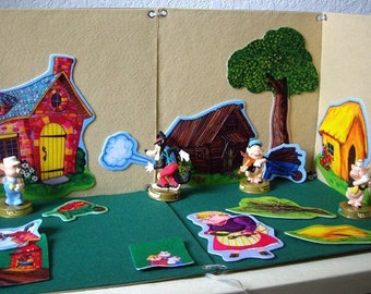 The Three Little Pigs Felt Board playset with CD in English and Spanish and Read Along Story Book of the Three Little Pigs.
