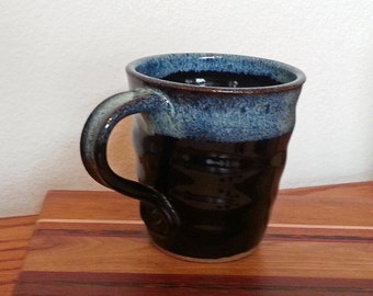 Ceramic Mug Spiral Twisted Shape in Gloss Black with Blue Speckled Rim