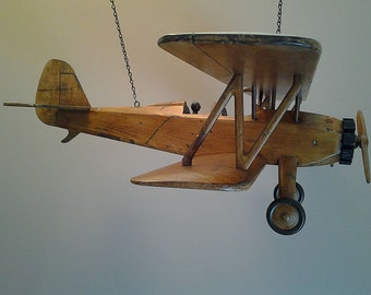Sold: Convo to reserve. The Barnstormer. A limited edition depiction of a vintage biplane.