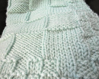 Hand knit basket weave baby blanket in a sea foam green