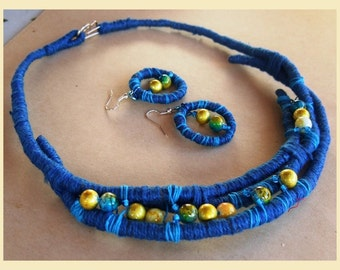 Cotton yarn wrapped jersey necklace and earrings set with yellow and blue glass beads