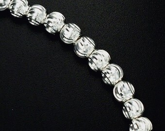 20 of 925 Sterling Silver Diamond Cut Spacer Beads 5mm. :th2270