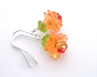 Orange flower earrings in lucite and glass - layered lucite and Czech glass flower dangles, orange and green. Orange Fall jewelry