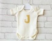 custom initial organic cotton baby vest : handprinted, metallic gold, star, letter personalisation