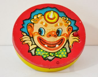 Vintage New Year's Eve Noise Maker Tin Spinning Yellow Blue Red Clown Metal Wood T. Conn Inc. 1960's