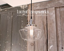 """Schoolhouse Lighting With 10"""" Clear Schoolhouse Glass Shade and Exposed Socket Design"""
