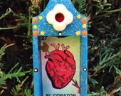 Nicho Ornament - El Corazon. Turquoise, Red, Black with Colorful Accents.
