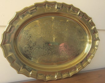 Oval brass tray for home organization decor.