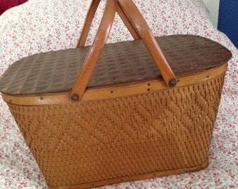 Pack a Feast in This Sturdy Woven Picnic Basket With Metal Handles.