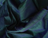 One yard of 100 percent pure dupioni silk in dual colors of indigo and green