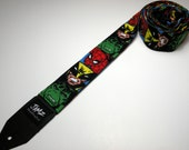 Faces of comic book characters on a handmade double padded guitar strap - This is NOT a licensed product.