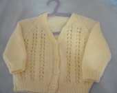 hand knitted baby cardigan 6 to 9 months in Cygnet dk in lemon C6