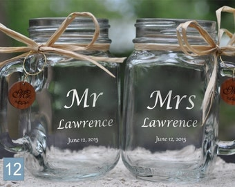 Engraved Wedding Mason Jars Mr and Mrs with Last Name.  Font and handle direction choices. Comes with Wooden Charms.