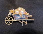 1928 Jewelry Gold Tone Brooch Flower Cart with Pearls and Pink Rhinestones