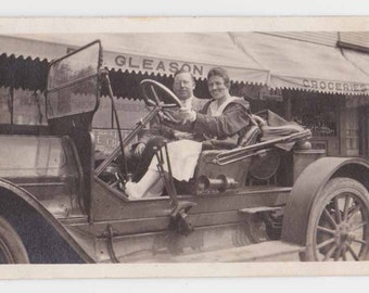 Pasadena CA  Woman Driver old convertible   CAR Jalopy sedan at Gleason Groceries RETAIL Store shop vintage Photo old photograph