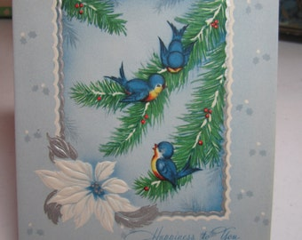 Pretty 1940's embossed silver gilded christmas card cute bluebirds on holly berry branches white poinsettia