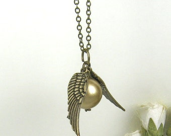 Antique brass golden snitch necklace, angel wing necklace, simple chic necklace, metal charm bead pendant