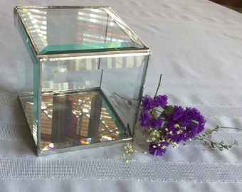 A 4 x 4 x 4 inch square clear beveled glass box to display special loved treasures