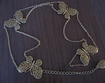 Groovy 70s filigree butterfly and chain belt