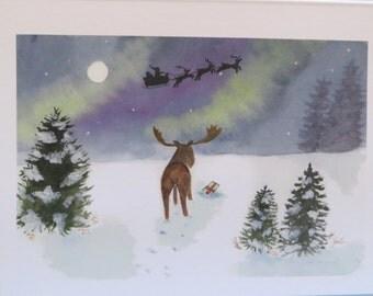 Set of 10 Christmas cards with moose, northern lights and santas sleigh.