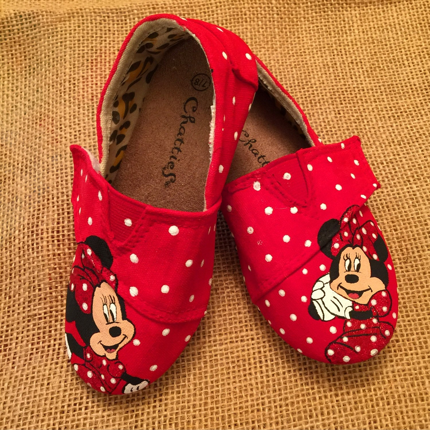 Baby Minnie Mouse Shoes - results from brands Disney, Minnie Mouse, Crocs, products like Disney Minnie Mouse Collapsible Storage Square Pop Hamper, Pink, Disney Minnie Collapsible Pop up Hamper , Minnie Mouse Black & Pink Bow-Accent Slipper - Infant.