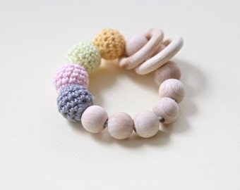 Soft and sweet toy. Teething ring toy with crochet wooden beads. Rattle for baby.