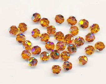 Twelve dazzling limited edition Swarovski crystals: art 5000 - 8 mm - topaz AB 2X