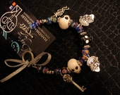 Day of the Kate Day of the Dead Dia de los Muertos charm bracelet catrina key skeleton skulls glass
