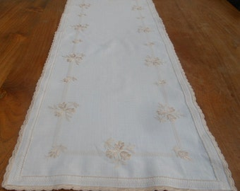 White linen table runner with floral ecru embroidery