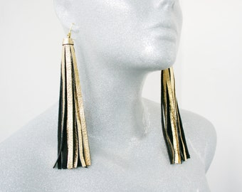 Black/gold colored leather tassel earrings