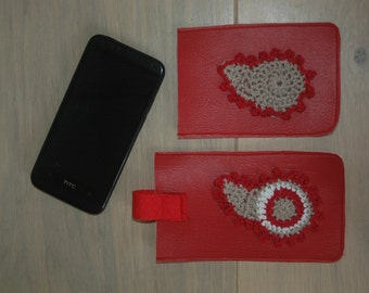 Leather mobile sleeves with crocheted paisley decoration