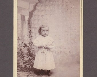Cabinet Card of an Apprehensive Little Girl with her Doll