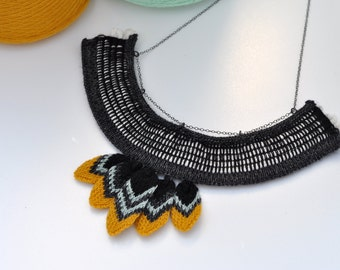 Knitted Trapped Rope with Feather Detail Necklace - Black, White, Slate Grey, Ice Blue and Mustard