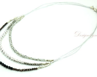 Jet and clear crystal,silver beads on silk necklace.