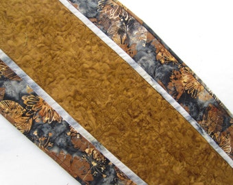 Tan, caramel, and gray blue quilted table runner. 12 1/2 x 43 inches