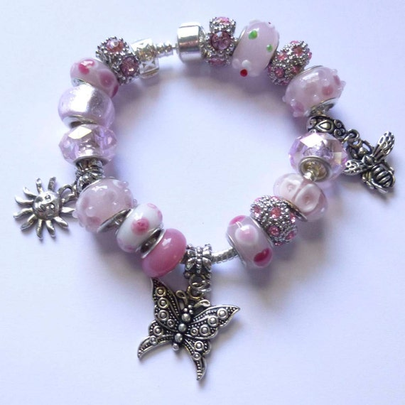 Pink Crystal  European Style Charm Bracelet  with a Butterfly, Bee and Sun Charms and Pink Muran Lampwork Beads