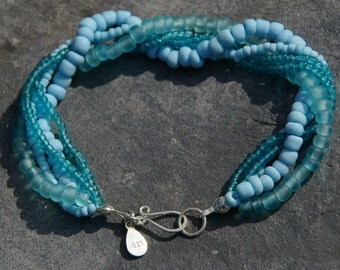 Sea blue glass beaded bracelet with sterling silver clasp