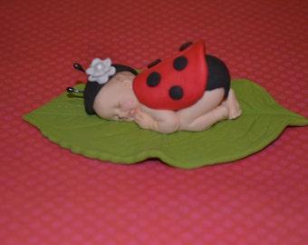 Sleep baby ladybug cake topper