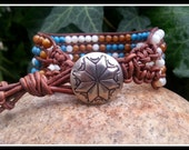 Southwestern Style Five Strand Beaded Leather Cuff Bracelet with Amber and White Shell and Reconstituted Turquoise Beads