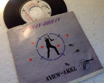 """1985 View to a Kill vinyl 7"""" - James Bond 007 Roger Moore Tanya Roberts"""