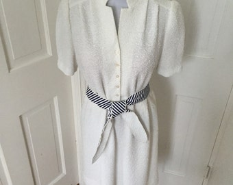70's white textured belted button front day dress