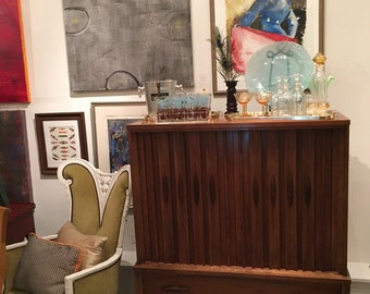 Mid Century modern dresser . Csn also be converted into s bar .