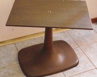 Vintage brown tulip base swiveling TV stand