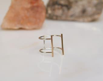 Large, minimal mixed metal open cuff ring