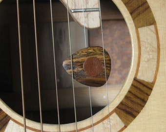 Exotic Bocote wood guitar pick with leather friction pads.